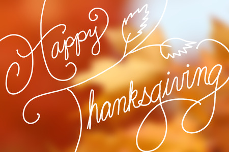 43272691 - happy thanksgiving text design on blurred orange maple leaves